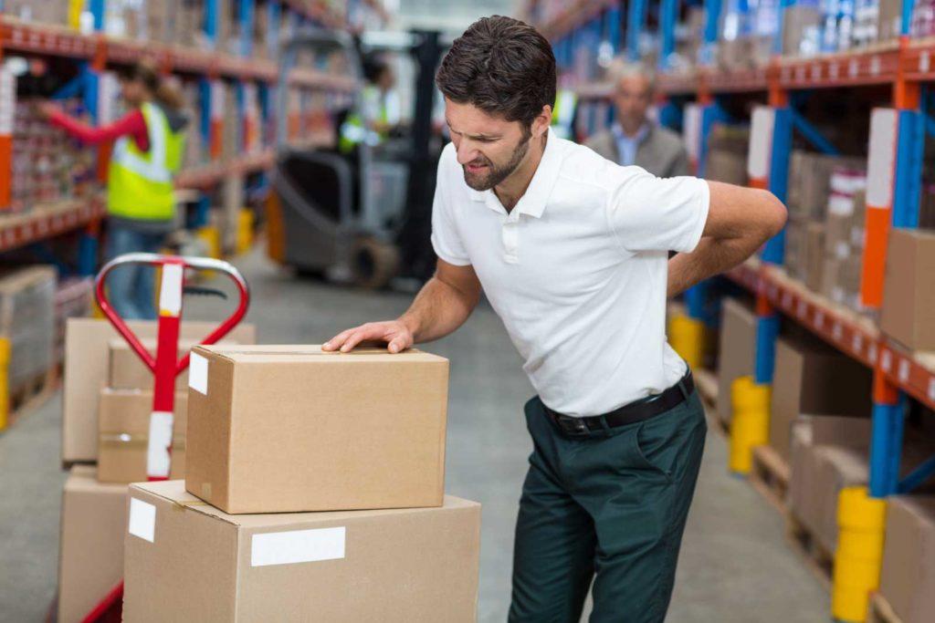 Warehouse employee aching in back pain
